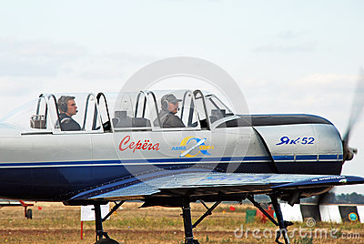 Two pilots sit in the sports plane and look into the distance Editorial Stock Image
