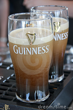 Two pints of beer served at The Guinness Brewery Editorial Photo