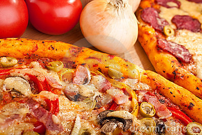 Two pizzas close up