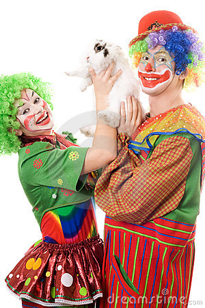 Two playful clown with a white rabbit