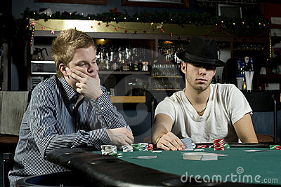 Two poker players with poker faces