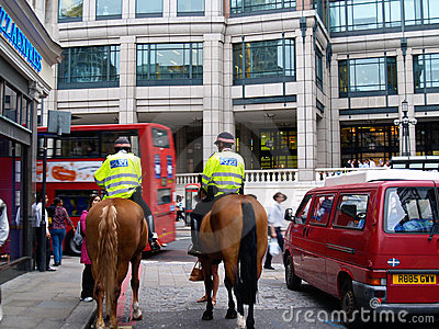 Two policemen patrolling London street Editorial Photo