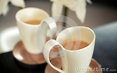 Two porcelain cups of coffee