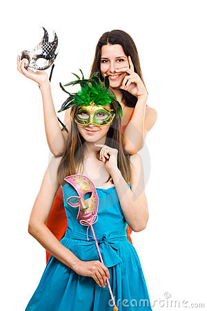 Two positive young women with mask at masquerade p