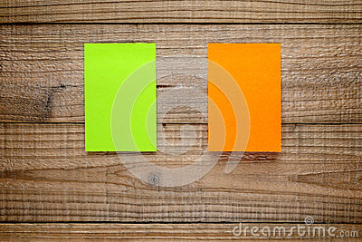 Two post-it notes on wood