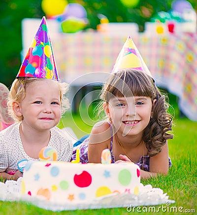 Two pretty little girls celebrating birthday