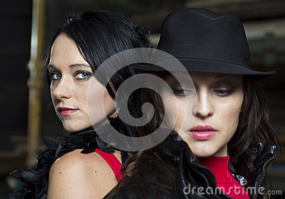 Two pretty mafia ladies back to back