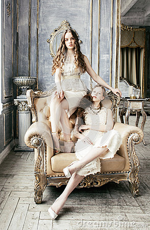 Free Two Pretty Twin Sister Blond Curly Hairstyle Girl In Luxury House Interior Together, Rich Young People Concept Closeup Royalty Free Stock Image - 92850906
