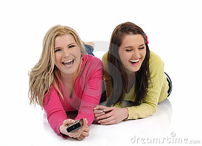 Two pretty woman friends watching television
