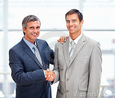 Two professional business men greeting eachother
