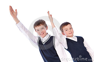 Two pupils raise their hands up