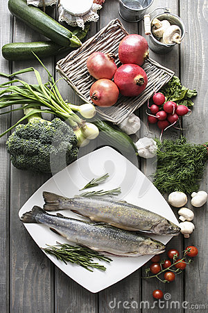 Free Two Raw, Fresh Rainbow Trouts Among Vegetables. Royalty Free Stock Photo - 40384765
