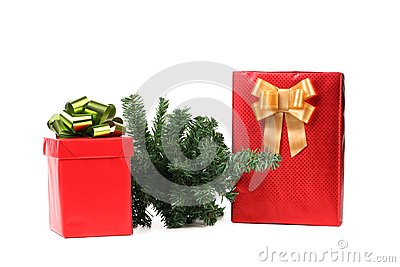 Two red boxes with bows and christmas tree.