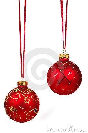 Two red Christmas balls on a red ribbon