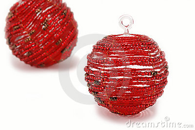 Two red glass christmas ornaments