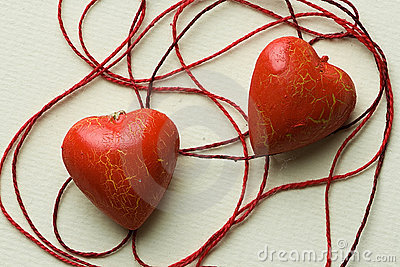 Two red heart shapes in cotton cobweb