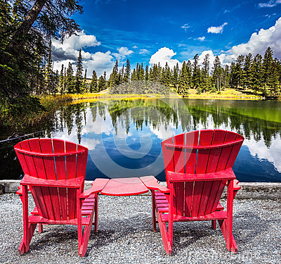 Free Two Red Plastic Chairs On The Lake Royalty Free Stock Images - 88315249
