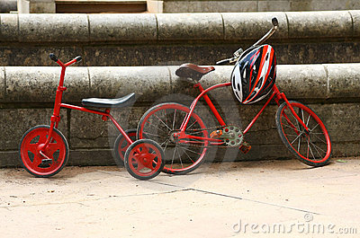 Two red retro bicycles