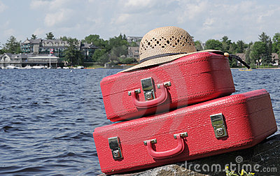 Two red suitcases and straw-hat