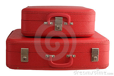 Two red vintage suitcases