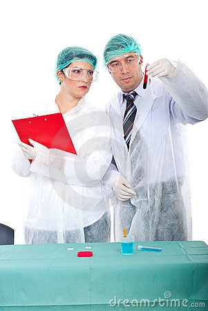 Two researchers with blood tube in laboratory