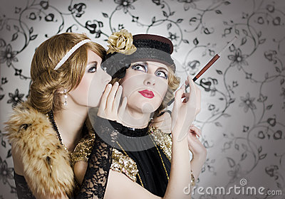 Two retro styled women sharing secrets