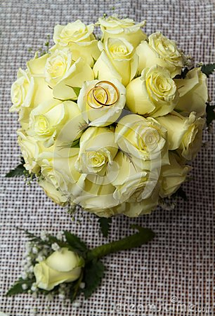 Two rings on the bouquet of roses