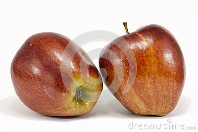 Two ripe red apples