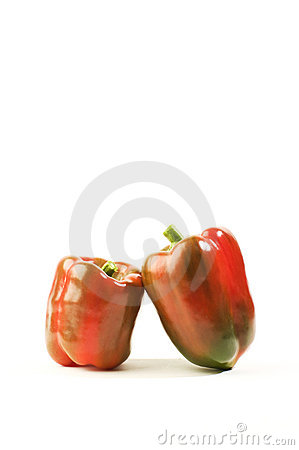 Two ripe red peppers.