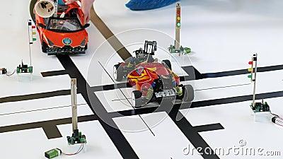 Robotic car models almost crashed at a crossroads