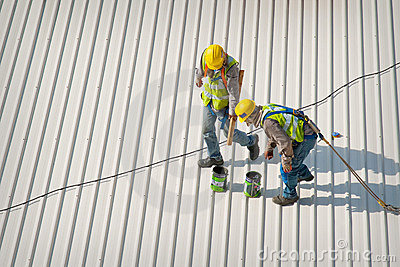 Two rooftop workers