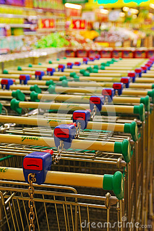 Free Two Rows Of Parked Shopping Carts Equipped With Co Royalty Free Stock Photos - 34705778