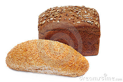 Two ruddy loafs of bread with sunflower seeds