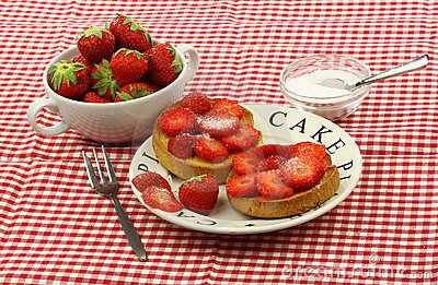 Two rusks with sugared strawberries