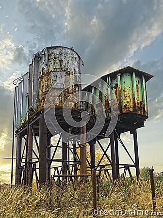 Two rusty industrial barrels