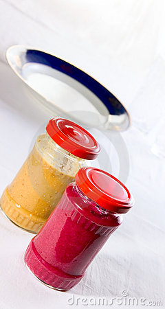 Two sauce in jars