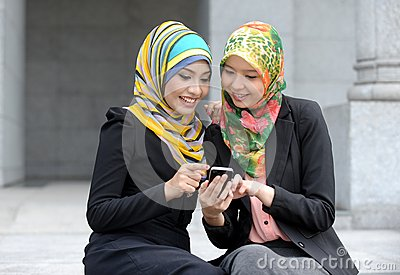 Two Scarf girl using smart phone