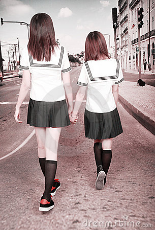Two schoolgirls outdoors.