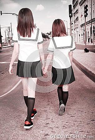 Two schoolgirls outdoors.
