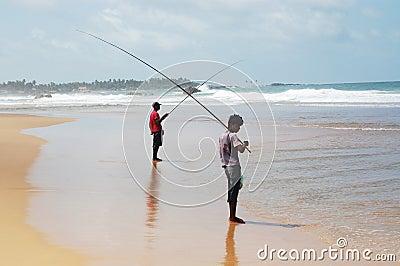 Two sea fisherman's on coast Editorial Stock Photo