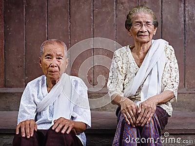 Two senior asian women looking at camera