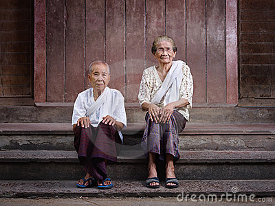 Two senior asian women looking at camera