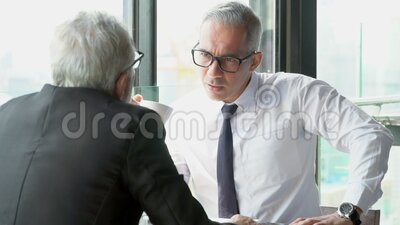 Two senior businessman discussion with partnership about work at office, executive meeting and conversation for success. Older man with friend talking and deal stock footage