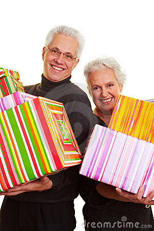Two senior citizens with gifts