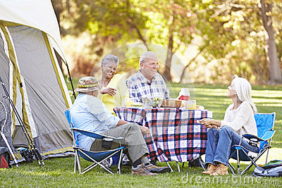 Two Senior Couples Enjoying Camping Holiday