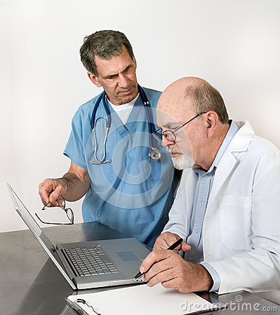Two Senior Doctors at Laptop Computer