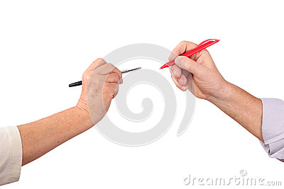 Two senior hands hold pens