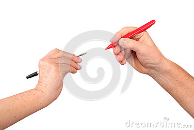 Two senior hands hold red, black pens