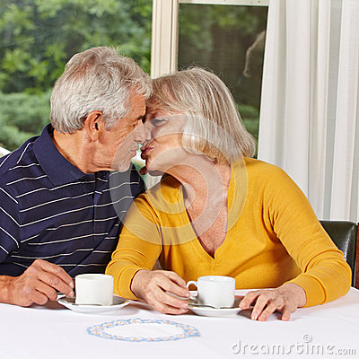 two senior people in love kissing stock photo image