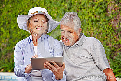 Two senior people with tablet computer